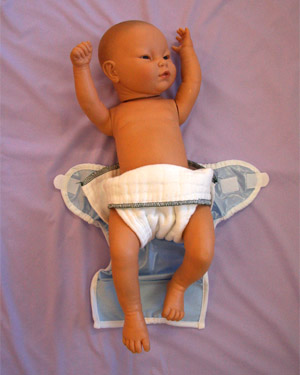 Step 5: Flip Diaper Downward and Fan Over Hips